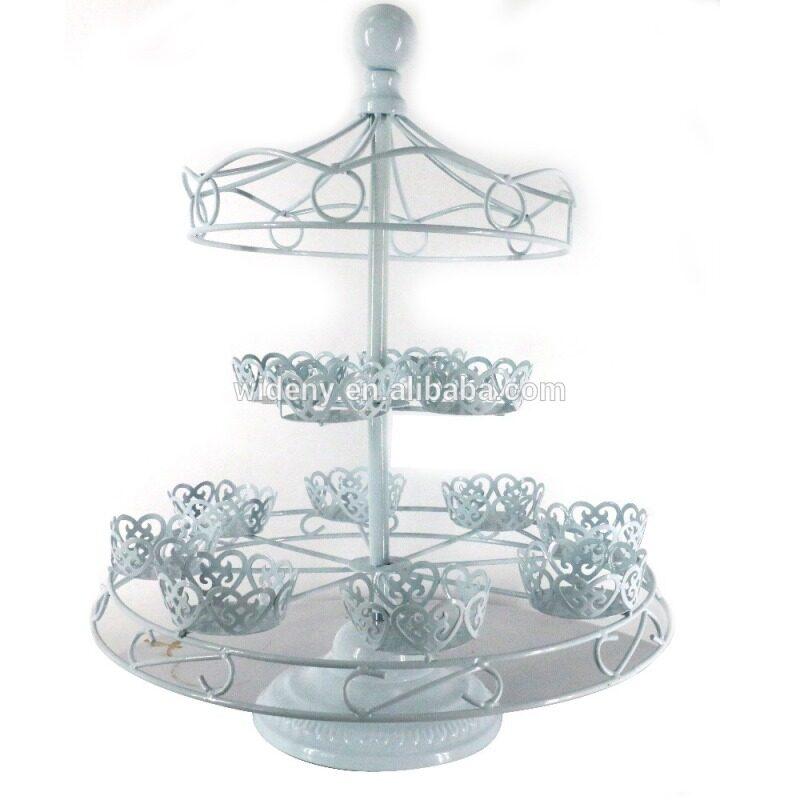 Revolving white metal fountain wedding cake stand
