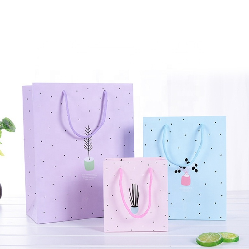 China manufactures customized pink lining bag gift paper