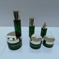 Wholesale duannypack dark green cosmetic lotion cream 2oz day cream glass jars for skincare