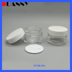 Wholesale cosmetic matte frosted clear green cosmetic glass cream jar with lid for creams and lotions 2 oz cream jar glass