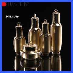 DNLA-530 Gold Acrylic Lotion Pump Bottle with Crown Cap