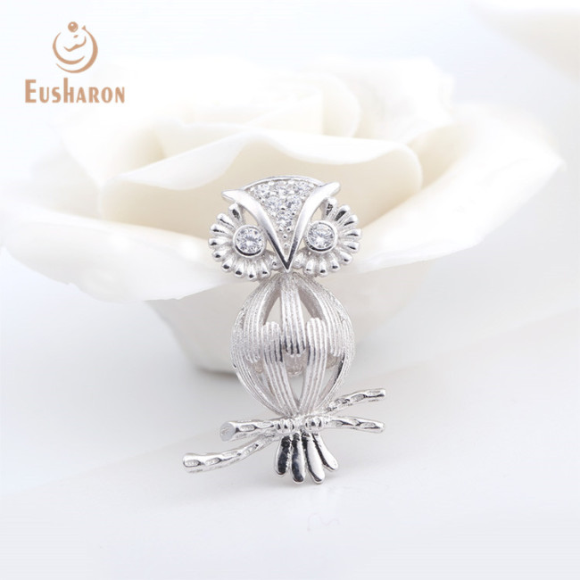 Owl on tree with whic CZ eyes sterling silver cage pendant