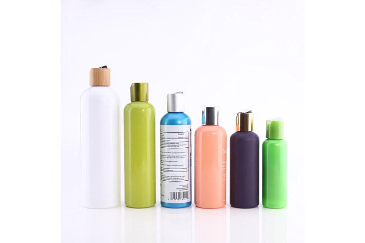 Disc cap top PET bottle for cosmetic toner