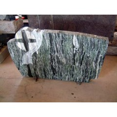Green Granite cross carved monument