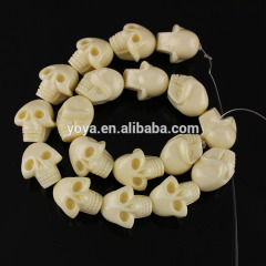 GP0842 Large creamy ivory resin plastic skeleton skull head beads