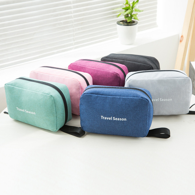 Portable washing bag in hand for travel