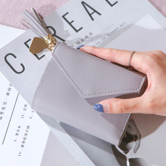 Factory direct new lady's purse female tassel pendant litchi pattern wallet card bag zero wallet spot wholesale