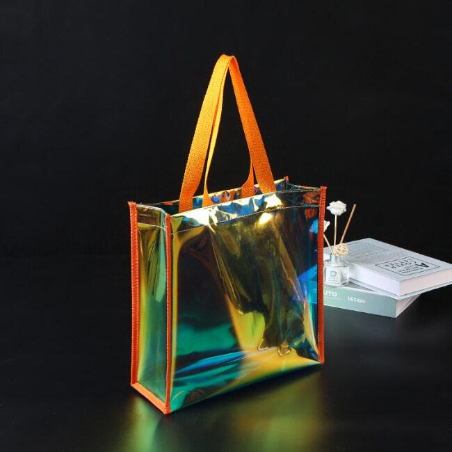 PVC laser advertising gift bag customized transparent colorful plastic shopping cosmetic bag customized logo