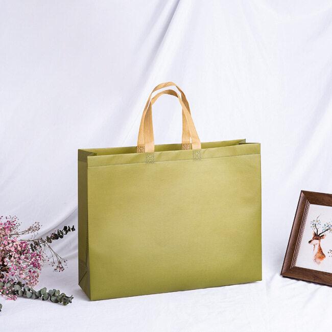 Manufacturers wholesale non-woven bag color coated spot shopping bag customized non-woven bag plus printed logo
