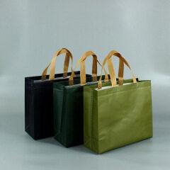 Plastic coated non-woven children's handbag custom men's and women's clothing store shopping bags, environmental protection bags, custom printed logo