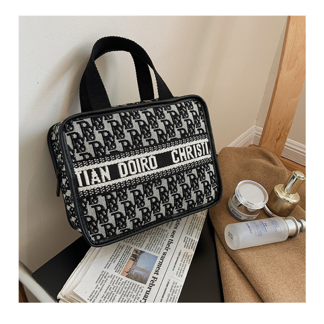 Fog flower new European and American style letter hand washing bag make up bag hand lunch box bag make up box Mommy bag