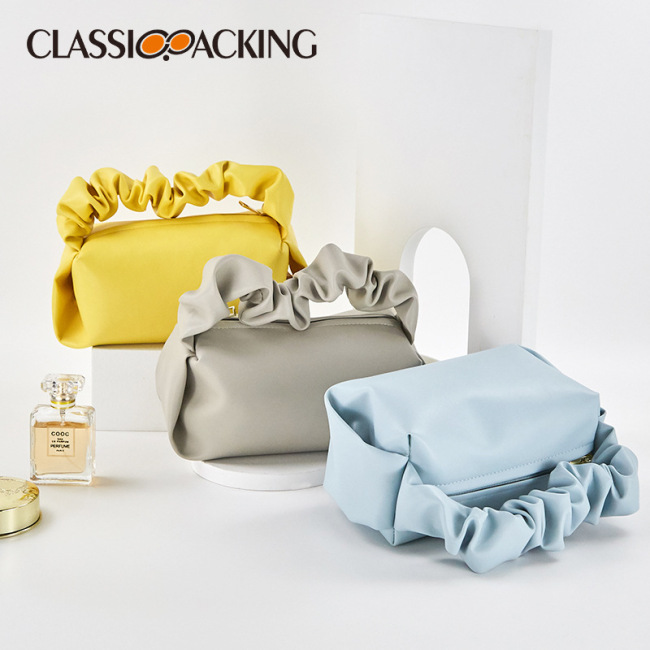 2021 new ins net red pure color simple portable cloud bag minority texture PVC leather pleated women's makeup bag