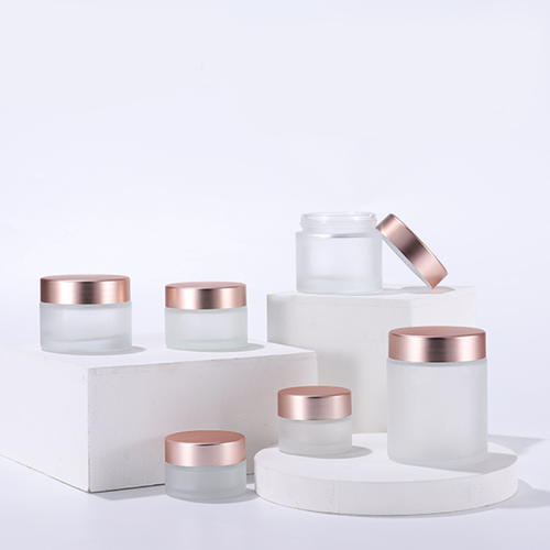 wholesale luxury frost 30g 50g 80g 100g matte rose gold cap lotion bottles for day nignt cream bulk glass jar cosmetic packaging