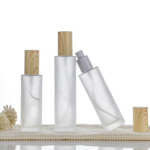 custom bamboo 30ml/50ml/100ml private labling screw lid eye cream empty lotion bottles with pumps glass cosmetic  packaging